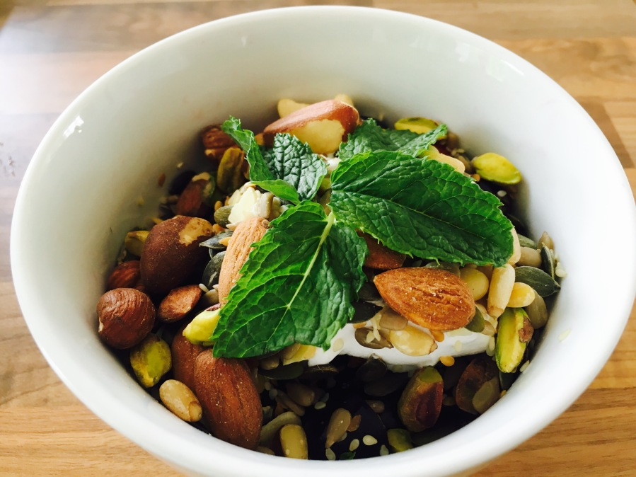 Fruit and nut breakfast bowl with coconut yogurt