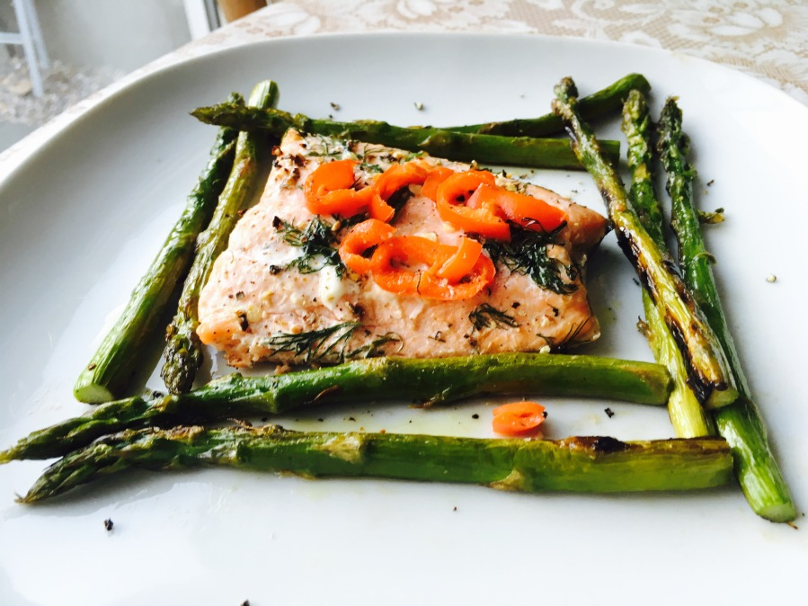 Char-grilled dill and chilli peppers fresh salmon fillets with asparagus tips