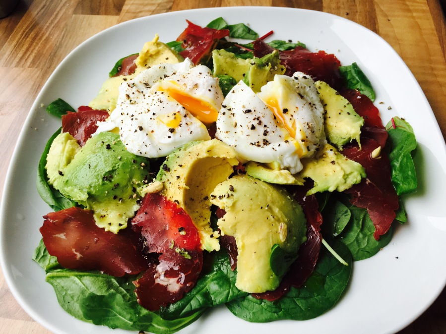 Poached eggs, bresaola and avocado salad