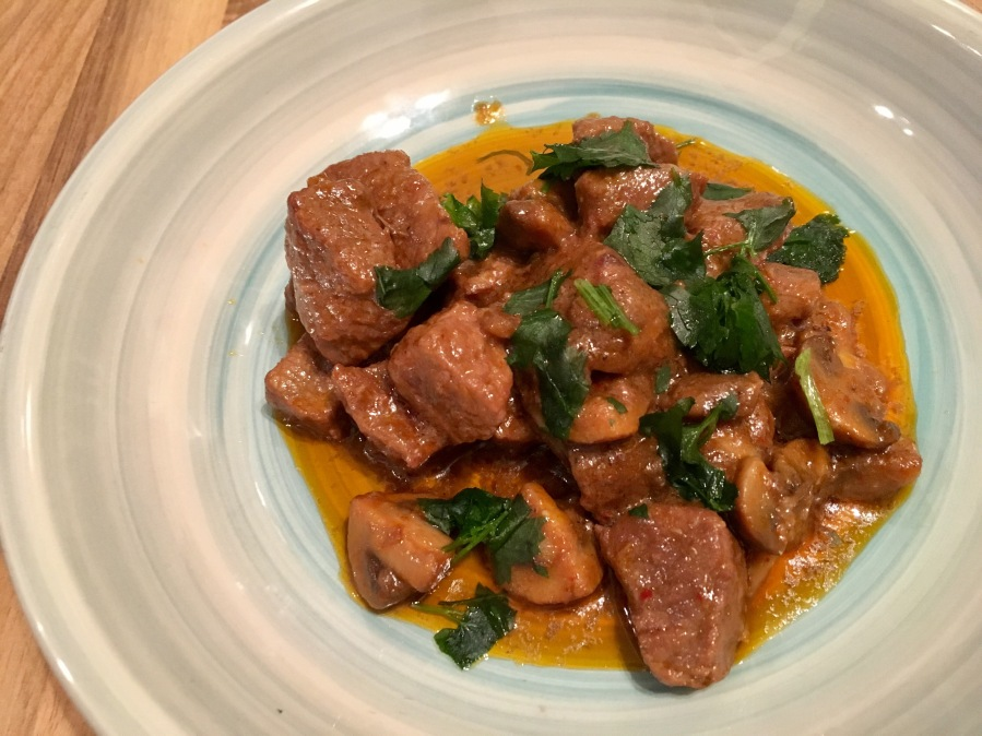 Thai style slow cooked beef and mushrooms in coconutmilk